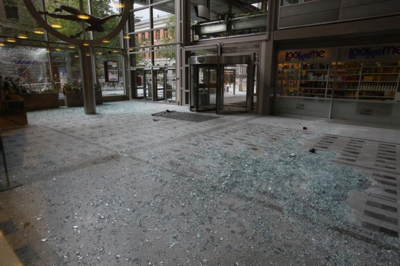 Broken glass lies in the shopping mall and office building of Norway's biggest newspaper VG in Oslo