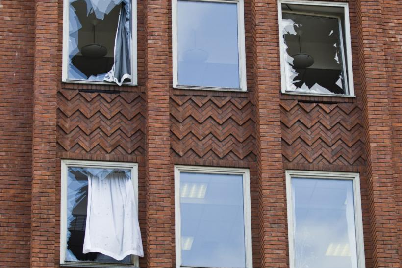 Broken windows are seen at the Labour Party headquarters building after the bomb blast in Oslo