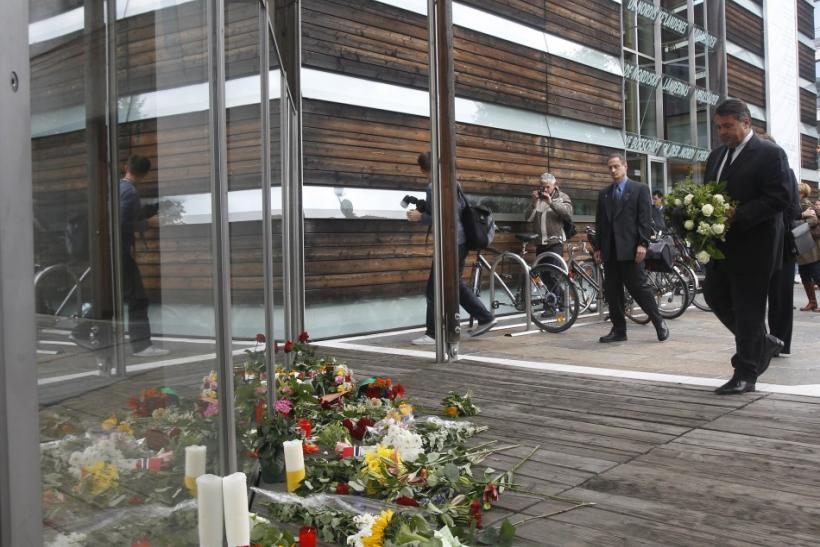 Leader of Germany's Social Democratic Party (SPD) Sigmar Gabriel lays flowers at the Nordic embassies to Germany in Berlin