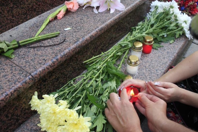 People put flowers and light candles near Norway's embassy in Riga July 23, 2011. A suspected far-right gunman in police uniform killed at least 84 people in a ferocious attack on a youth summer camp of Norway's ruling Labour party, hours after a bomb kil