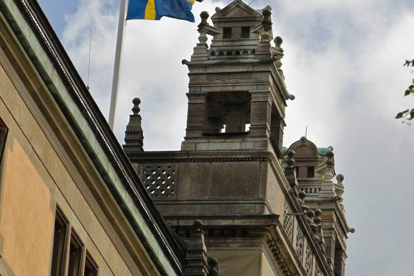 The Swedish national flag flutters at half-mast atop the Rosenbad government building in Stockholm July 23, 2011, in show of support for the victims of Friday's bomb blast and shooting which took place in Norway.
