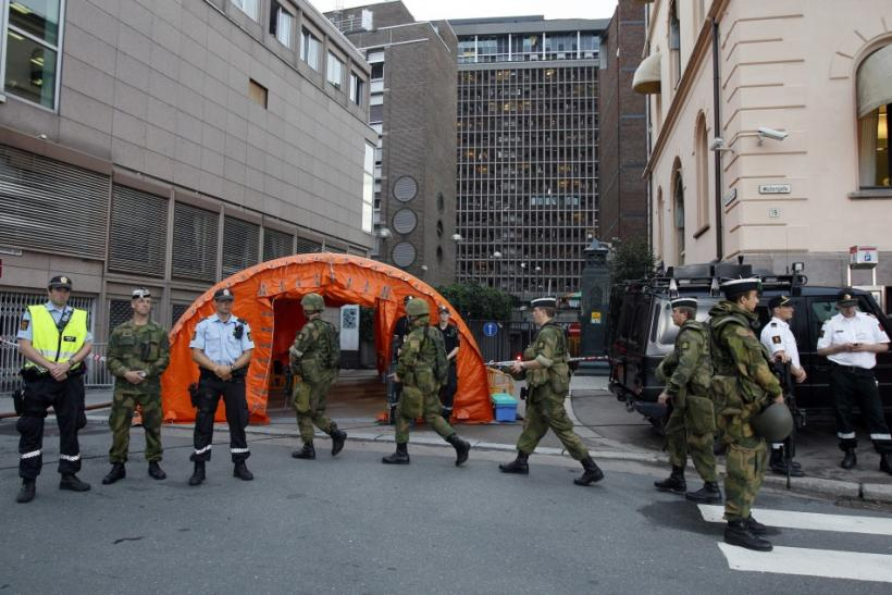 Norwegian army and policemen deploy near the blast site in the capital Oslo