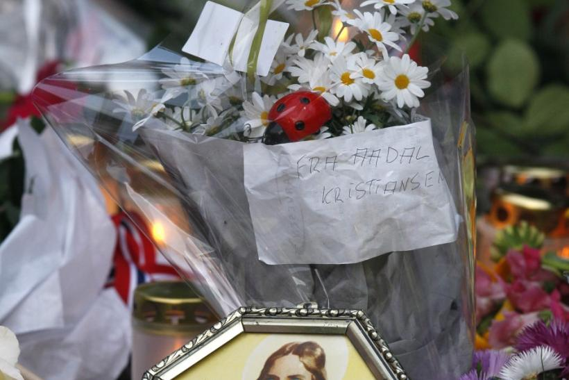 An image of Jesus Christ is seen among flowers to mourn the victims of a shooting spree on an island in the countryside and a bomb attack in the capital Oslo July 23, 2011. Pope Benedict expressed sympathy Saturday for the victims of a suspected right-win