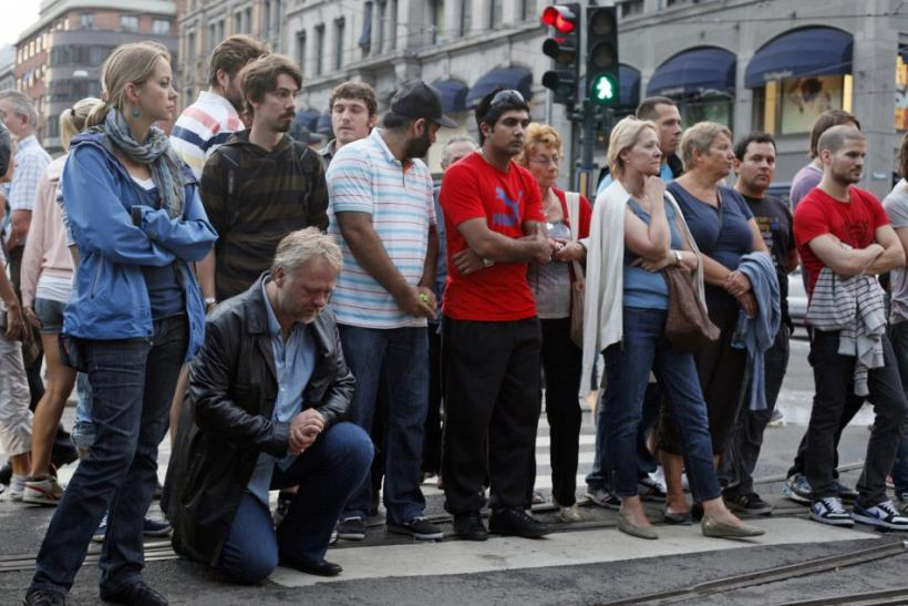 People mourn the victims of a shooting spree on an island in the countryside and a bomb attack in the capital Oslo July 23, 2011. Norwegian police searched for more victims and a possible second gunman on Saturday after a suspected right-wing zealot kille