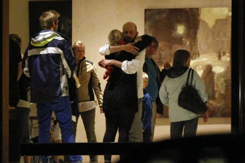 People embrace inside a hotel where relatives of victims and survivors of the shooting which took place at a meeting of the youth wing of Norway's ruling Labour Party on Utoeya island gather in Sundvollen