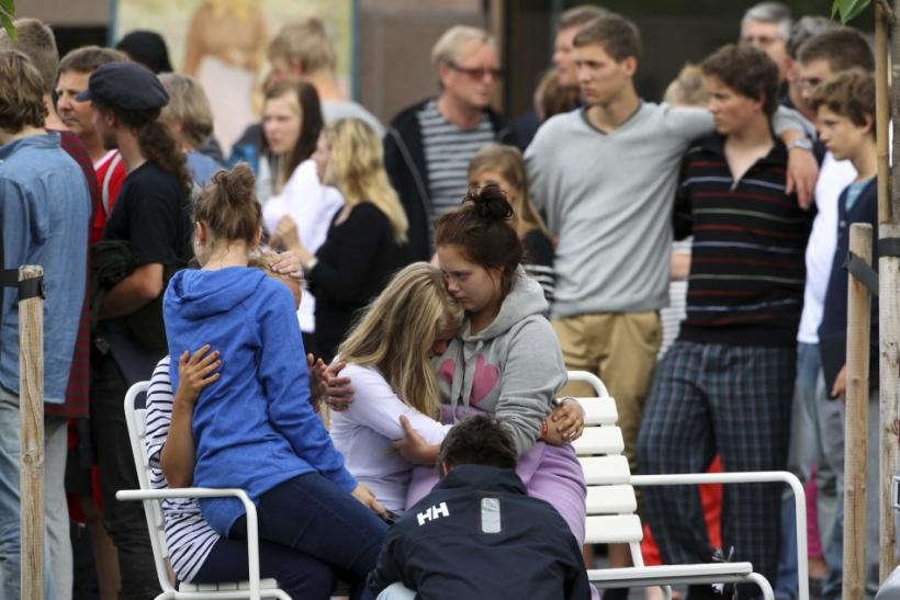 Family members and survivors react as Norwegian King Harald and Queen Sonja (not seen) arrive to comfort them outside a hotel in Sundvollen, northwest of Oslo July 23, 2011.