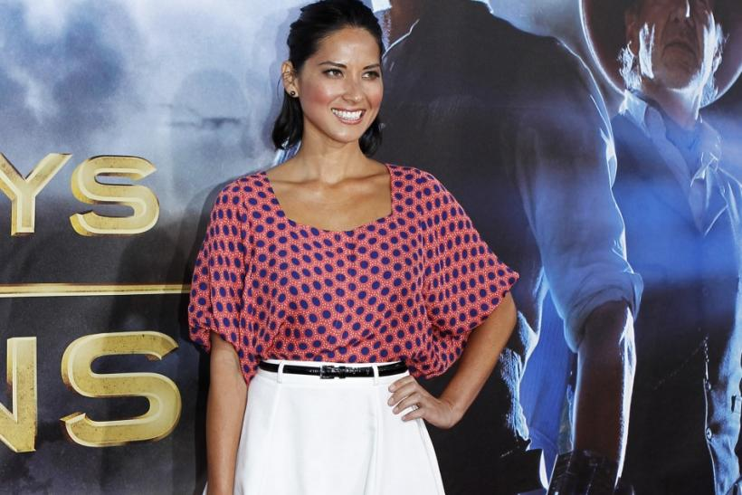 "Actress Olivia Munn arrives for the world premiere of ""Cowboys & Aliens"" in California"