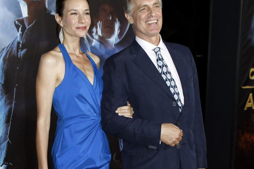 "Actor Keith Carradine and his wife Hayley DuMond arrive for the world premiere of ""Cowboys & Aliens"" in California"