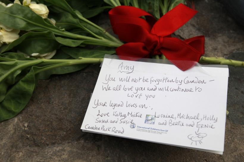 Flowers and a note are seen outside the home of Amy Winehouse in London