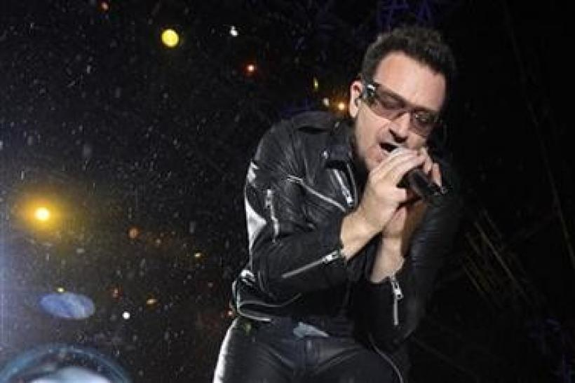 Bono, lead singer of Irish band U2, performs
