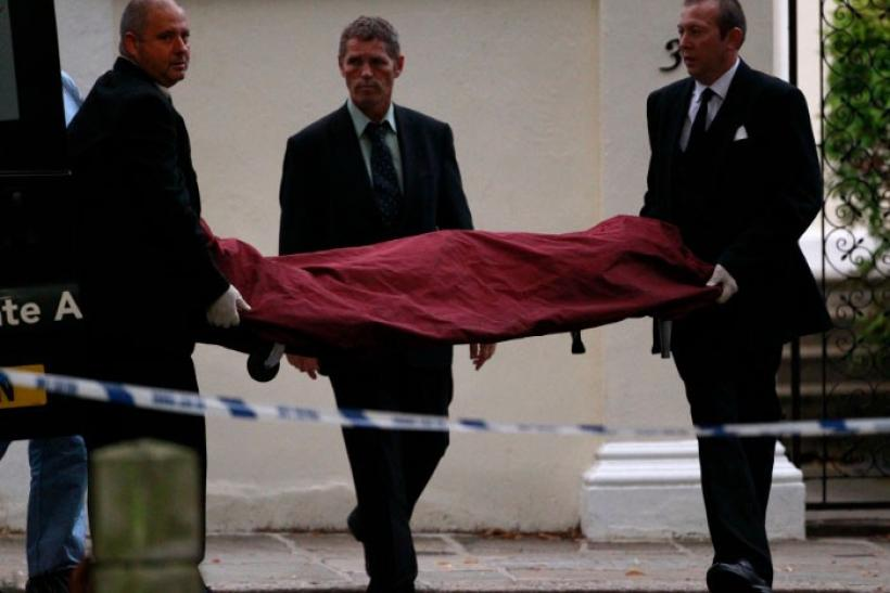Funeral workers carry the body of Amy Winehouse outside her house in London July 23, 2011