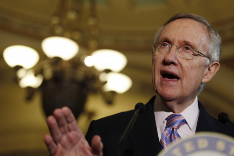 U.S. Senate Majority Leader Harry Reid speaks to the press during debt reduction talks on Capitol Hill in Washington
