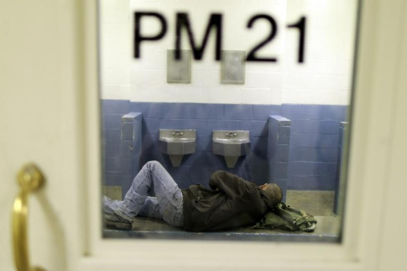 An inmate lies in his cell at the Orange County jail in Santa Ana, California