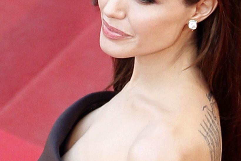 Tattoos are pictured on the left arm of actress Jolie as she arrives at the 64th Cannes Film Festival