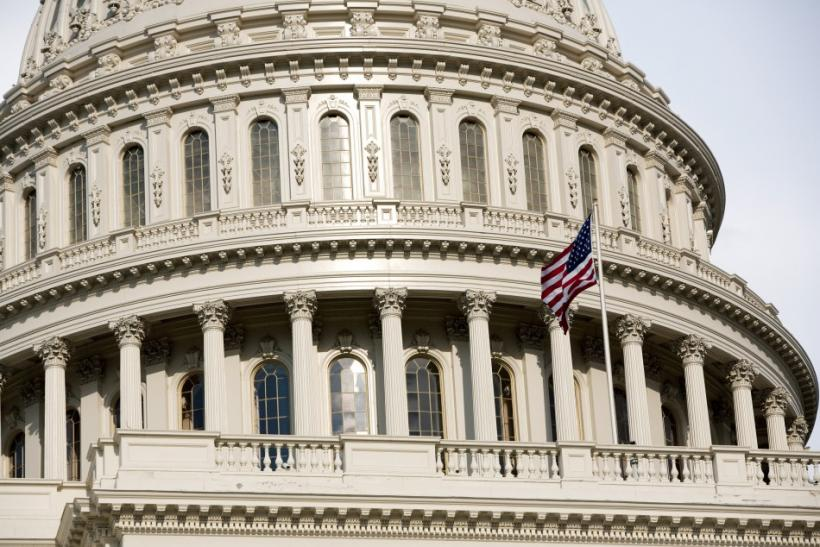 The U.S. flag flutters in the breeze at Capitol Hill in Washington