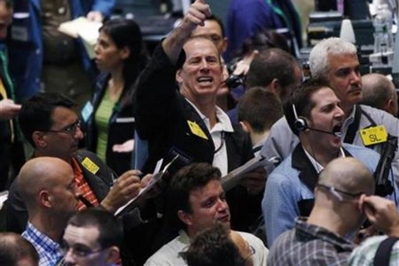Traders work in the crude oil and natural gas options pit on the floor of the New York Mercantile Exchange
