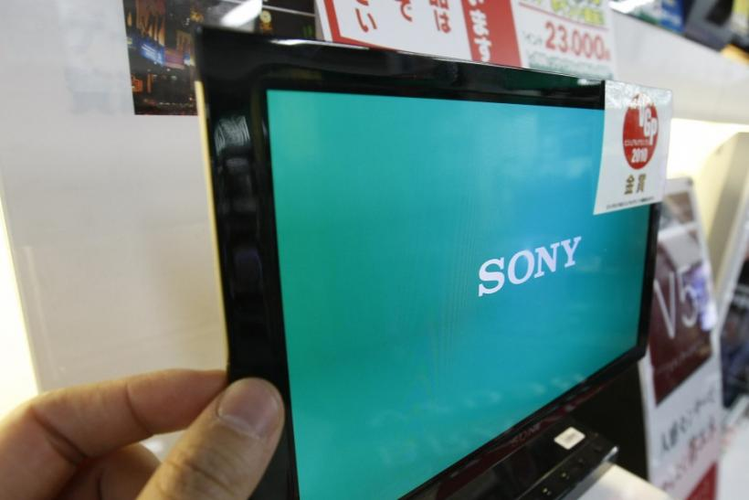 A man touches Sony's OLED TV during a photo opportunity at an electronic shop in Tokyo