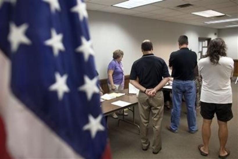 Voters take to the polls as Wisconsin holds the nation's largest ever recall elections in River Hills