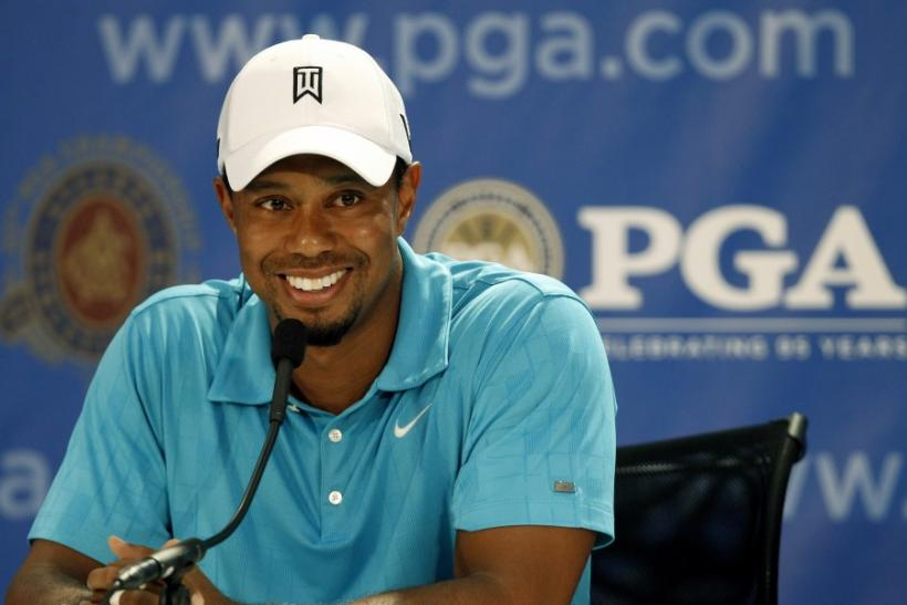 Tiger Woods talks to the media during his news conference before the start of the 93rd PGA Championship golf tournament at the Atlanta Athletic Club in Johns Creek