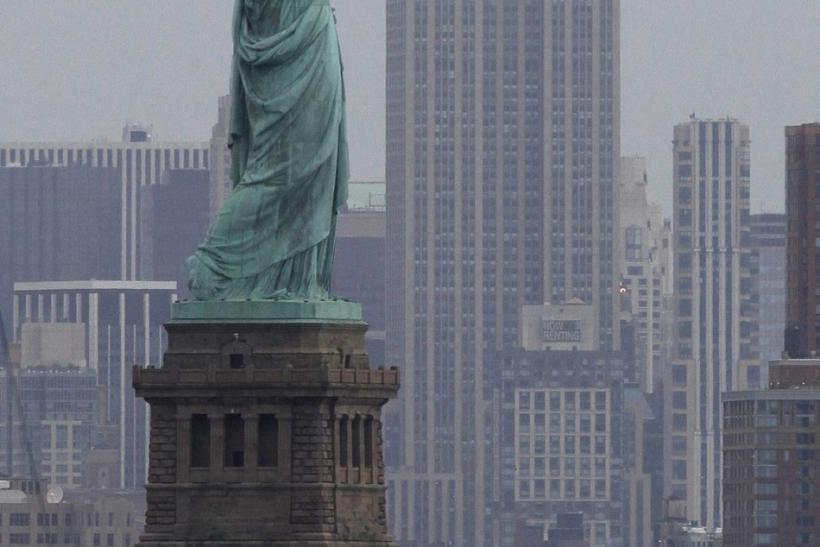 The Statue of Liberty sits next to the Empire State Building as seen from Bayonne