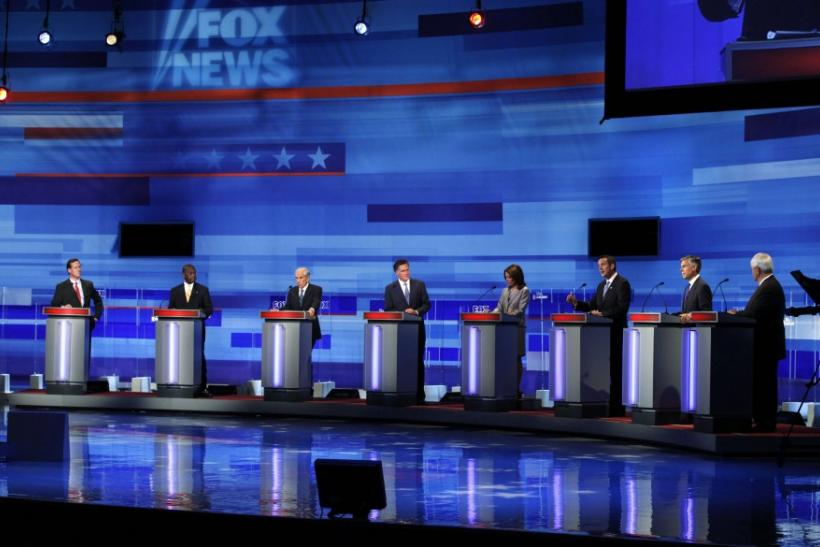U.S. Republican presidential candidates attend a debate in Ames