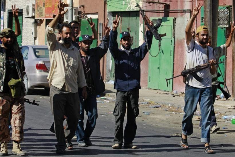 Libyan rebel fighters celebrate after taking partial control of the coastal town of Zawiyah