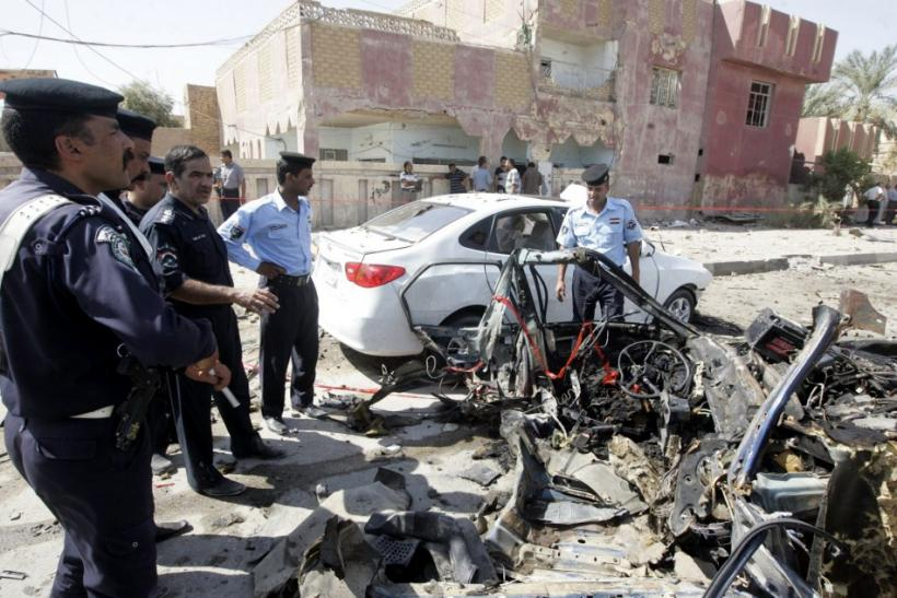 Policemen gather at the site of a bomb attack in Najaf