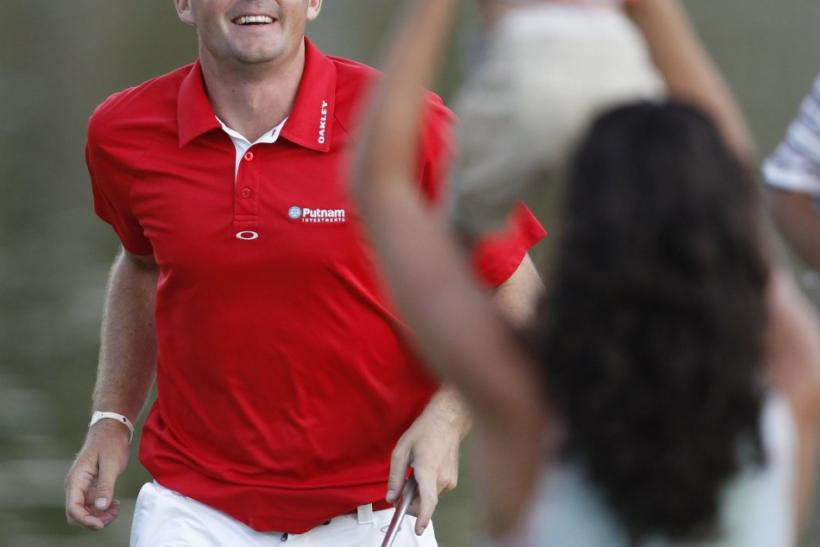 Bradley runs to greet his sister and his nephew after he won the PGA Championship golf tournament at the Atlanta Athletic Club in Johns Creek