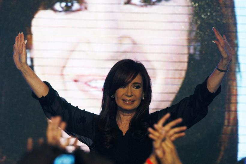 Argentine President Fernandez waves to supporters after the announcement of the first results of the nationwide primary election in Buenos Aires