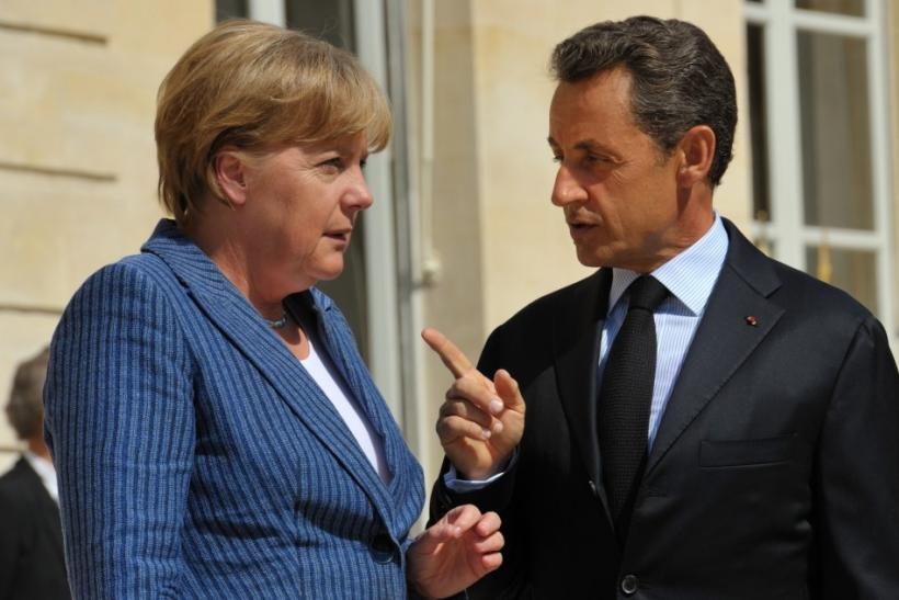 France's President Nicolas Sarkozy welcomes German Chancellor Angela Merkel as she arrives for a meeting at the Elysee Palace in Paris