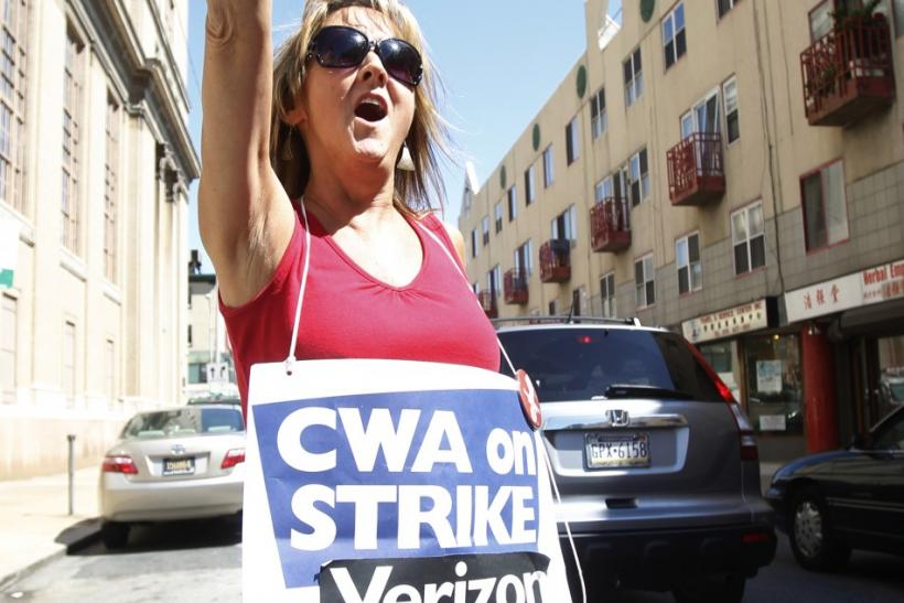 Verizon worker shouts while picketing at the Verizon office on ninth street in Philadelphia