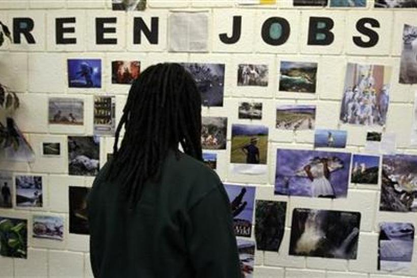 Student Brian Goode looks at pictures of green jobs on a wall at the Youth Opportunity (YO!) Academy and the Westside Youth Opportunity Community Center in Baltimore