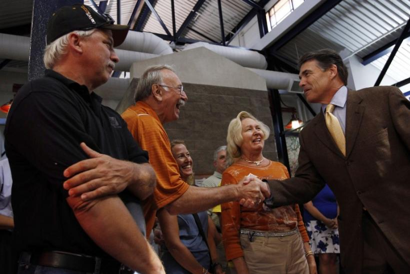 U.S. Republican presidential candidate Texas Governor Rick Perry greets people during a campaign stop in Walcott, Iowa