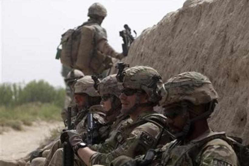 Canadian and U.S. army soldiers attached to 1st Battalion, 22nd royal regiment rest during a patrol in the Panjwai district of Kandahar province in southern Afghanistan