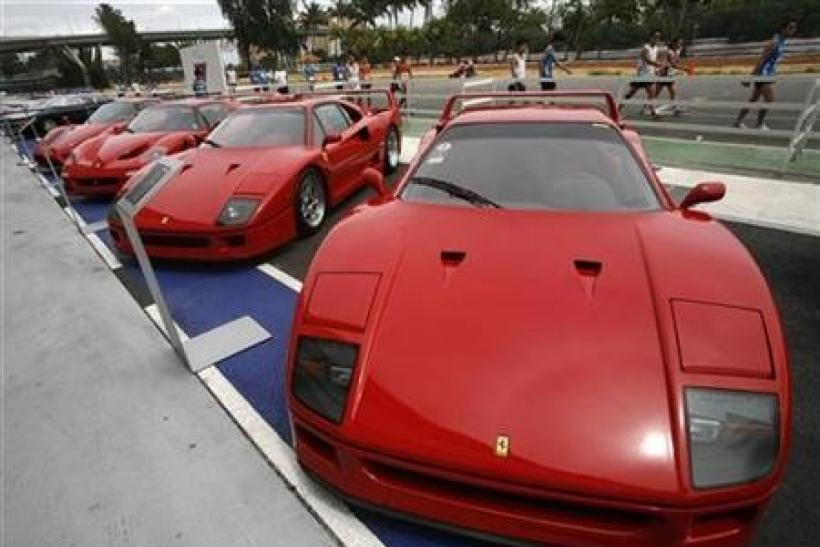 Ferrari cars, including the F40 (R and 2nd R), F50 (2nd L) and Enzo sit on display during a show of luxury cars in Singapore