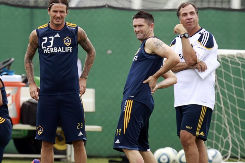 Ireland's Robbie Keane (C) stands with David Beckham (L) and coach Bruce Arena as he trains with Los Angeles Galaxy for the first time after signing with the MLS soccer team in Carson, California