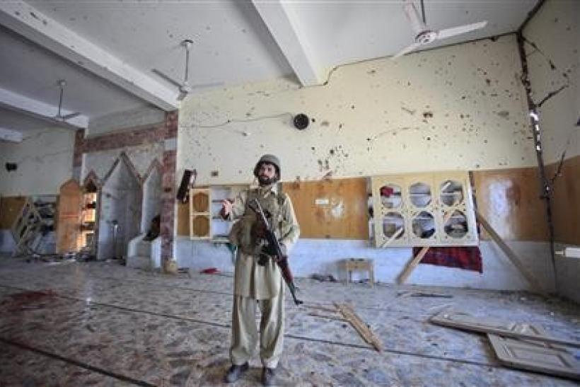 A paramilitary soldier secures the site of a sucide bomb attack inside a mosque in Jamrud, located in Pakistan's Khyber region