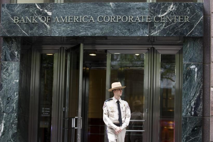 A private security guard keeps an eye on the sidewalk outside of the Bank of America Corporate Center in Charlotte