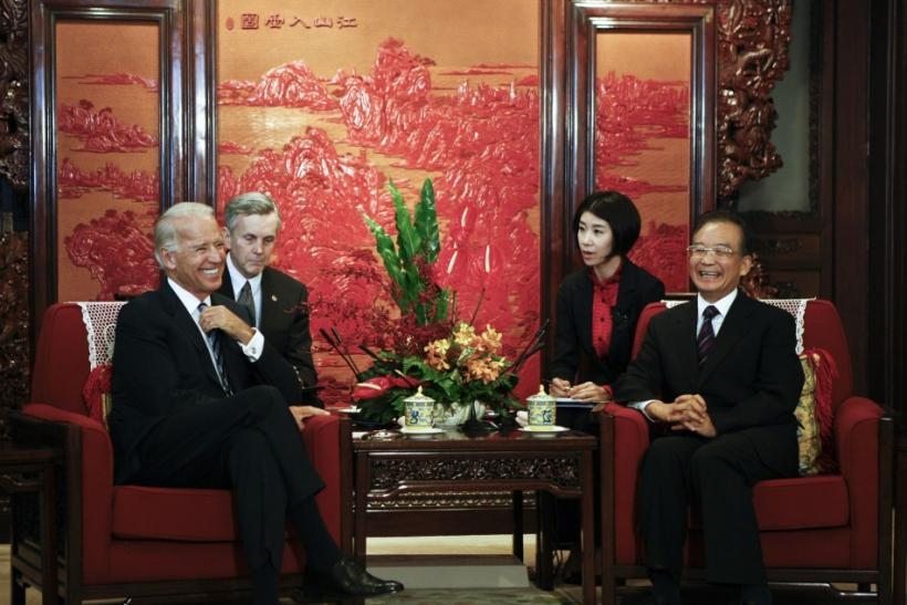 U.S. Vice President Biden and China's Premier Wen smile during their meeting at Zhongnanhai leadership compound in Beijing