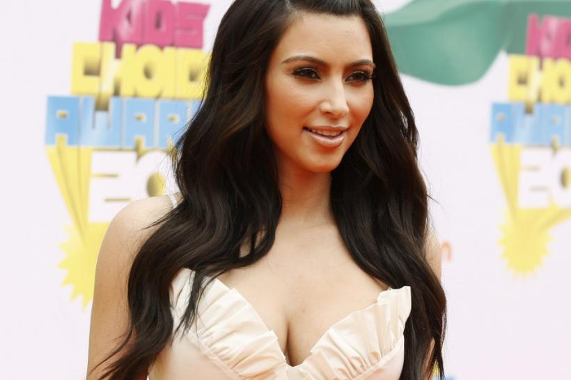 Television personality Kim Kardashian poses at the 2011 Nickelodeon Kids Choice Awards in Los Angeles