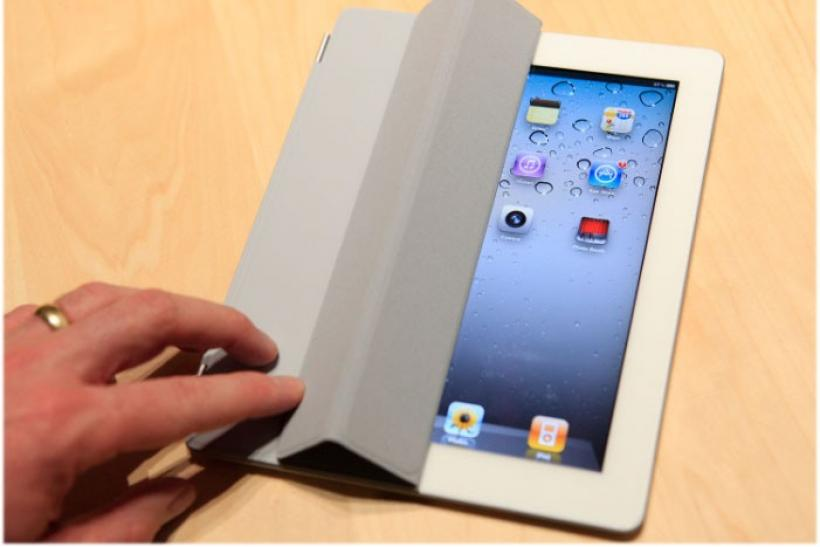 The iPad 2 with a Smart Cover is shown in use in the demonstration area after the iPad 2 launch during an Apple event in San Francisco, California March 2, 2011
