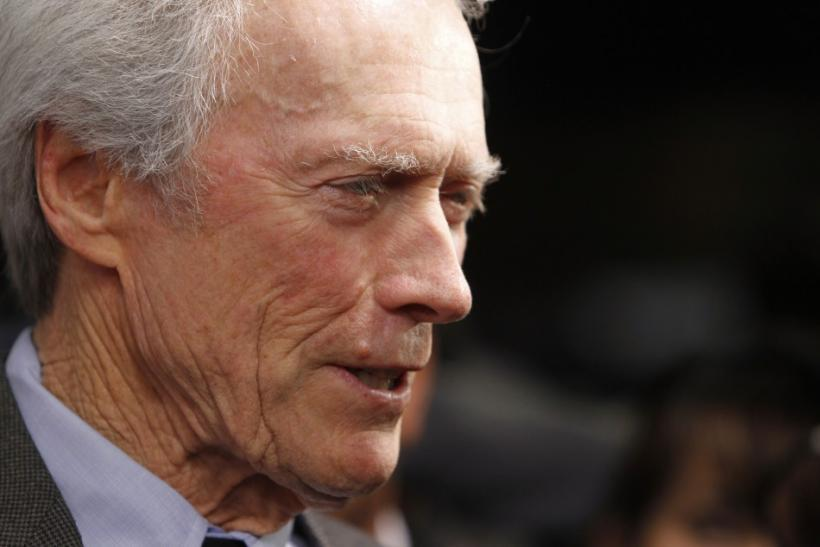 Director Clint Eastwood is interviewed as he arrives at the Museum of Tolerance International Film Festival gala awards presentation in his honor in Los Angeles