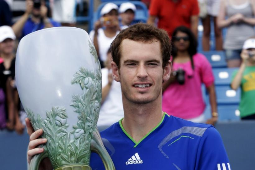 Murray of Britain holds up the championship trophy after defeating Djokovic of Serbia in the championship match of the Cincinnati Open tennis tournament