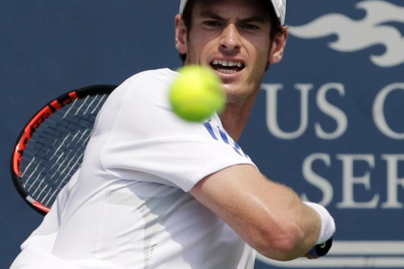 Murray of Britain hits a return to Djokovic of Serbia during their championship match of the Cincinnati Open tennis tournament