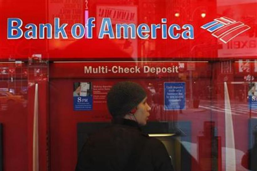 A customer uses an ATM machine inside of a Bank of America branch in Times Square in New York