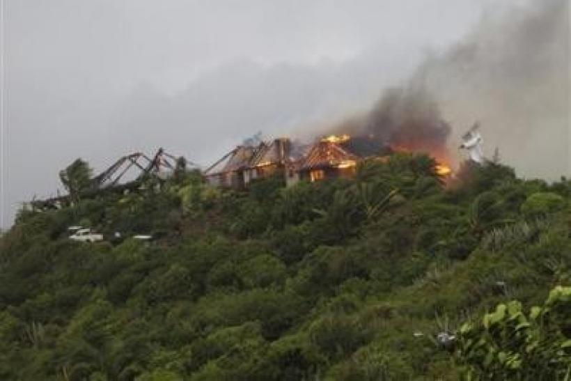 A fire sweeps through Richard Branson's Caribbean holiday retreat in this photograph taken and released