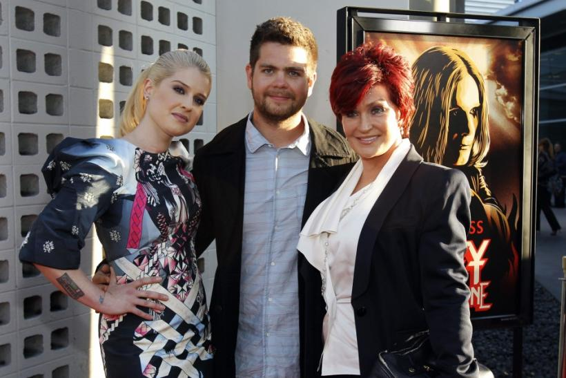 "Director Jack Osbourne (C) poses with his mother Sharon Osbourne (R) and his sister Kelly Osbourne at a private preview of the documentary ""God Bless Ozzy Osbourne"" at the Arclight Cinerama Dome in Hollywood, California"