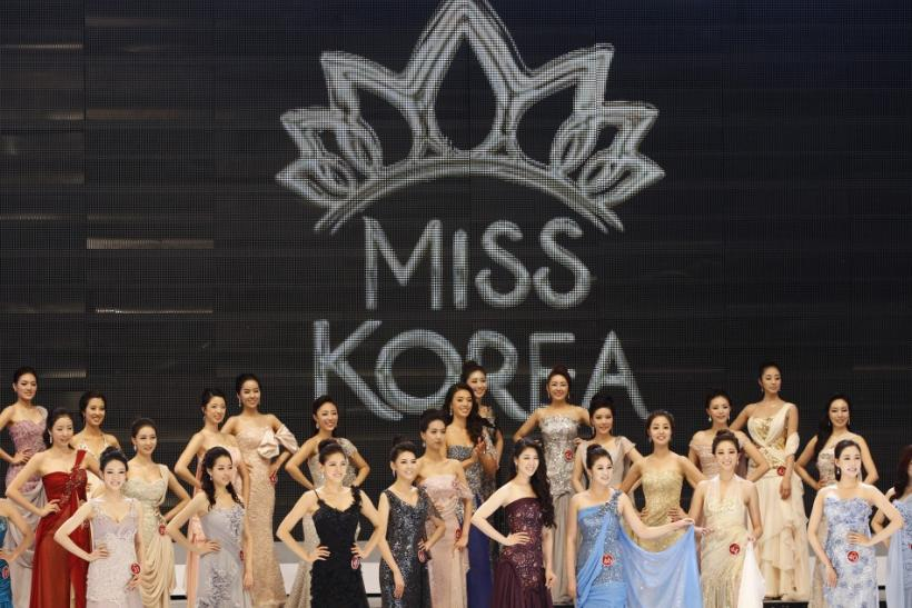 Participants of the 2011 Miss Korea Pageant wait onstage to be called into the round of 16 during a beauty contest in Seoul