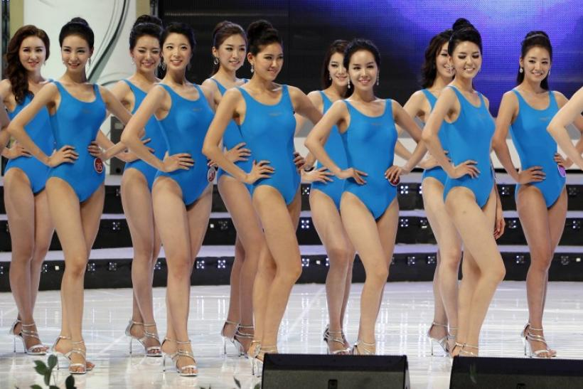 Participants of the 2011 Miss Korea Pageant pose for the swimsuit competition during the beauty contest in Seoul