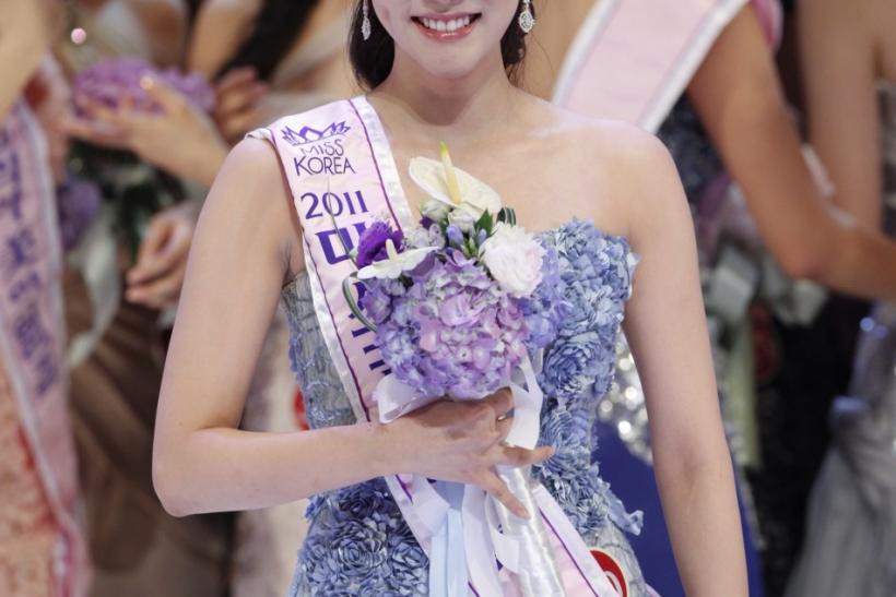 Winner of the 2011 Miss Korea Pageant Lee Sung-hye celebrates after she was crowned in Seoul
